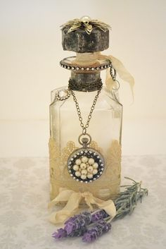 Antique bottles paired with fresh cut blooms from the garden.  Swoon!    Mammabellarte: Soldered and embellished bottle