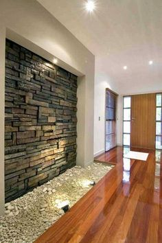 CraftStone is often used on exterior walls as stone wall cladding, but is now increasingly being used in interior design to create feature walls and focal points inside homes and businesses. Indoor Stone Wall, Faux Stone Sheets, Stone Feature Wall, Water Feature, Stone Wall Design, Unique House Design, House Entrance, Entrance Ideas, Entryway Ideas