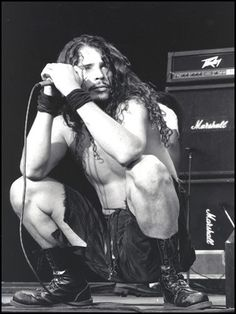 I'm impressed. A Rocker in Buddha Squat...A younger Chris Cornell.. still looks great!