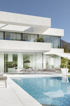 Contemporary home in Italy.  Minimalistic white House and white marble Pool deck. White & Clean private residence in the hills of Italy. Exquisite