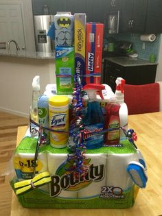 I did this fun housewarming gift for a friend and everyone really liked it.  Cleaning supply cake.
