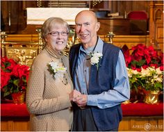 The couple of honor poses for a formal photo together on their 50th wedding anniversary during Christmas at Trinity United Methodist Church in downtown Denver Colorado. - April O'Hare Photography http://www.apriloharephotography.com #TrinityUnitedMethodistChurch #GoldenAnniversary #DenverPhotographer