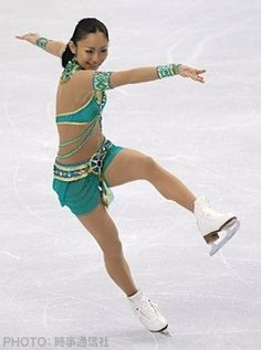 """Ando Miki at the 2010 Winter Olympics - Free Skate  [from Japanese:  Miki Ando's """"Cleopatra"""", Wearing exotic costume of gold to the emerald green of the Olympic specifications, The world of the ice, such as change in the Egyptian desert, has developed a world of Cleopatra Mikiti. 3 consecutive jump of rotation -3 rotation, but to avoid to continuously jump of 3 rotation -2 rotation, In a little cautious, but I finished the performance with no mistakes."""