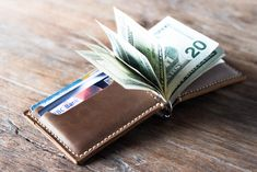 This leather money clip wallet is handmade and hand-stitched. Money clip wallets allow you to hold more and access it quicker.