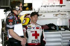 Greg Biffle (right) and Matt Puccia (left) prep for the evening Toyota Owners 400.   Credit: Action Sports Photography