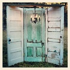 3 old doors hinged together with a chandelier hanging above vignette is a great store display or could be a Photo prop background for vintage wedding or used for a trade show or craft Booth display.  Repurpose, upcycle, recycle, salvage, diy!  For ideas and goods shop at Estate ReSale & ReDesign, Bonita Springs, FL by aftr