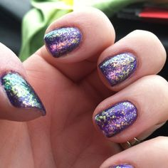 Sally Hansen Deep Purple with Essie Shine of the Times! I think I am obsessed with sparkles; did this last night!