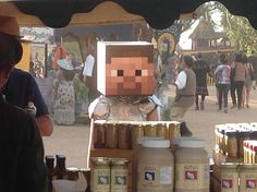 Minecraft cosplay at the renaissance festival...buying garlic. It was extremely random and an awfully hot day to be wearing a box on your head...and tinfoil. Poor little baked geeklette.