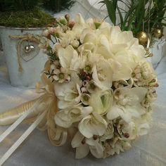 Bouquet da sposa, bridal bouquet, fresie, ranuncoli, fresie wax flowers