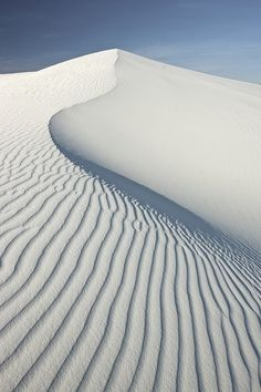 This picture of a sand dune is an example of environmental texture. This texture was made by the wind.