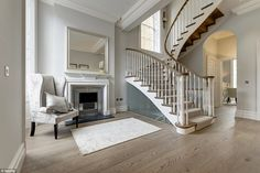 A lavish reception room and the decorative staircase. There's also a passenger lift servicing all four storeys and under-floor heating throughout. The beautifully-designed property is now on the market with estate agents Savills, with a guide price of £5.5m