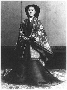 A vintage royal portrait. She is dressed in junihitoe