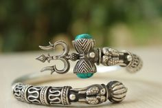 Silver Jewelry Special edition Trishul Kada made in pure sterling silver. This unisex kada has intricate work with a pair of turquoise in a bezel setting, situated inside a dumroo, leading into a Trishul. Silver Bracelets, Silver Earrings, Bracelet Designs, Sterling Silver Jewelry, Silver Ring, 925 Silver, Silver Jewellery, Antique Silver, Indian Jewelry