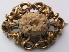 antique gold metal/carved ox bone floral cameo brooch