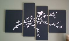 Take 4 canvases (2 of each size), paint them a solid base color and add vinyl or stenciled design. Love this! I see some new dead tree art on my walls in the near future!