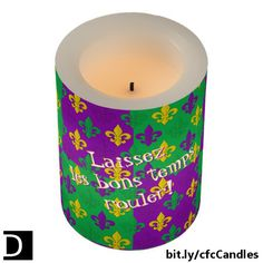 """This cool LED candle features a festive purple, green, and gold fleurs-de-lis Mardi Gras repeating pattern. The text, which says """"Laissez les bons temps rouler!"""", can be changed as you wish. Let the good times roll! (Available only at Zazzle.) https://www.zazzle.com/mardi_gras_fleur_de_lis_good_times_pattern_flameless_candle-256695768801799798?rf=238083504576446517&tc=20170424_pint_NI #homedecor #lighting #MardiGras #StudioDalio"""