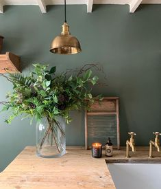 Another brilliant example of how to use green in the home. Painted in @farrowandball Green Smoke @simplyscandikatie on Instagram utility room exudes character with the reclaimed wooden worktop and touches of brass including our Mayan aged brass taps adding warmth and texture #perrinandrowe #brasstaps #farrowandball #utilityroomdecor #utilityroomdesignideas #laundryroom #homeinteriors #rusticdesignideas #brassdecor Utility Room Inspiration, Inspiration Wall, Brass Tap, Rustic Design, Deck, Green, Plants, Smoke