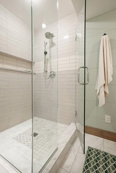 This luxurious oasis also features marble flooring and a sophisticated shower.