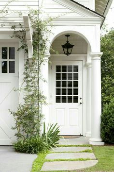 Inspiration: Calm + Bold Carriage house porch and garage door trellis.Carriage house porch and garage door trellis. White Front Door, Cottage Exterior, House With Porch, House Entrance, Best Front Door Colors, Door Trellis, Exterior Design, Farmhouse Front, Garage Door Trellis