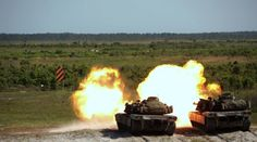 Marines deliver synchronized fire in their M1A1 Abrams tanks during a fire mission at Camp Lejeune, North Carolina, May 17, 2017. The Marines are participating in Burmese Chase, an annual, multi-lateral training exercise between U.S. armed forces and NATO members.    (U.S. Marine Corps photo by Pfc. Taylor W. Cooper