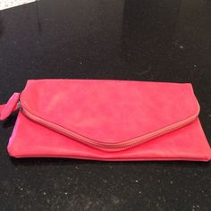Pink clutch. Pink fold over clutch. Magnetic closure. Has a zipper on top. Inside has a zippered pocket. Great condition. shiraleah Bags Clutches & Wristlets