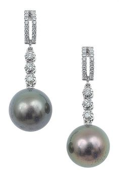 A pair of Tahitian pearl and diamond earrings, mounted in 18ct white gold - by Leonard Joel