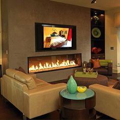 low profile gas fireplace with TV above;  TV is too high for comfortable viewing with a standard fireplace