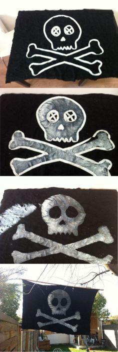 Drapeau pirate (Flag) DIY 1- Trouver un bout de tissu noir (2€) 2- Mettre du scotch pour faire la forme 3- Peindre avec un vieux pot de blanc 4- Retirer le scotch 5- Accrocher dans le jardin des caraibes