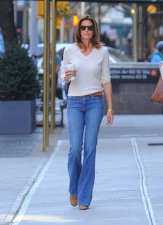Supermodel and 90's icon, Cindy Crawford brings back this 90's V neck sweater and faded denim boot cut jeans and does it extrangvently. The combo really does show off her figure and promoting her in this article advertises that this retro look can be achieved. Kenny H.