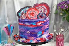 This Agate Cake has gorgeous, EDIBLE candy agate slices, and a pretty watercolor buttercream effect!