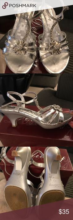 Sale! Silver Dress Sandals Like new! Great for holidays! Beautiful Silver Dress Sandals with Rhinestone flower on front & double row rhinestone t-strap on top. Cute low heel. Only worn once. Size 6&1/2 Delicacy Shoes Sandals