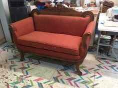 This settee took about 8 yards of fabric plus foam and batting. We also reconstructed the back legs.