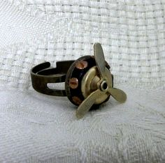 Steampunk ring propeller aviator adjustable  spinning antique brass polymer clay womens jewelry clothing accessories. $20.00, via Etsy.