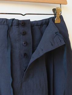 """Skirt inspiration: Linen-cotton """"Marlin"""" skirt with torchon lace accent stripe above hem pleats by Lisette formerly sold on Envelope Online Shop (Summer 2015). Waist fastens with back button placket, adjustable by drawstring hidden in yoke (shown in detail photo)."""