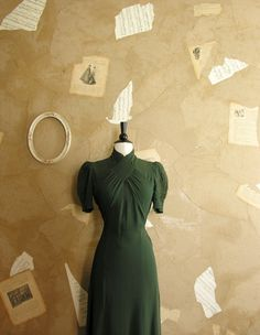 Dark olive leaf green crepe dress. Cross over neck and bodice and puffed sleeves ~