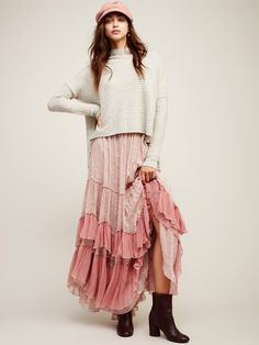 See You Tonight Maxi Skirt | Ultra femme maxi skirt with beautiful contrast ruffle details and a delicate floral print throughout. Exposed seams…