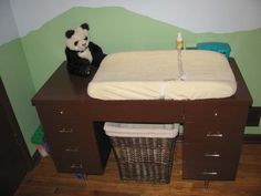 LOVE the idea of using a desk for a changing table. this one is rather plain, but it's a great idea! And a hamper or diaper pail where the shair would be? Baby Boy Rooms, Baby Room, Military Housing Decorating, Diaper Changing Station, Changing Pad, Baby On A Budget, Old Desks, Baby Decor, Baby Feeding