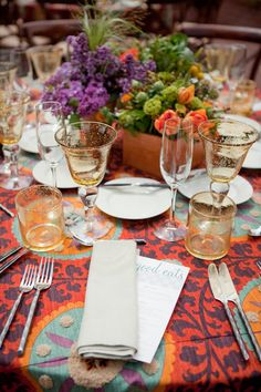 adore the entire crazy fun table! glasses, flowers and def the tablecloth!