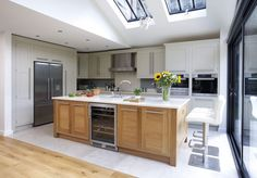 This walnut kitchen is a contemporary twist on a traditional shaker kitchen design, with statement island and luxury Sub-Zero appliances. Bespoke Kitchen Cabinets, Spacious Kitchens, Shaker Style Kitchens, Oak Kitchen, Bespoke Kitchens, Contemporary Kitchen, Cream And Oak Kitchen, Kitchen Style, Kitchen Renovation