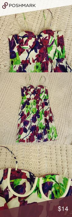 """Mod Floral Bustier Empire Waist Dress Mod Floral Bustier Empire Waist Dress. Underwire support,  back zipper closure. Runs Small. I'm normally an xs or 0 size 34 B - C. I've worn it with a jean jacket because my boobs seemed to spill out the sides. Cups are too small for me. I woukd say this is brst for an A cup to a small B cup bra size. Small cut in top layer of fabric just under 1/4"""" in size. IJust hanging in my closet. I have the same dress in a size 4 different pattern listed. Moda…"""