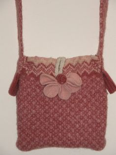 This Coral Pink white Felted messenger bag ipad case was created from an upcycled argyle wool sweater.  100% lamb's wool.  I nearly used up all materials in crating the bag.  with what came with the