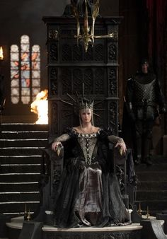 Charlize Theron as Queen Ravenna in Snow White and the Huntsman (2012).