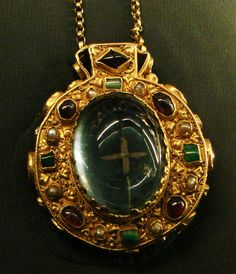 The #Talisman #of #Charlemagne, c. 768-814. Two large cabochon sapphires - one oval, one square - enclose holy relics (what are supposed to be a remnant of the Holy Cross and a small piece of the Virgin's hair, visible only when looking through the oval sapphire at the front of the medallion.) The other gemstones are garnets, emeralds, and pearls.