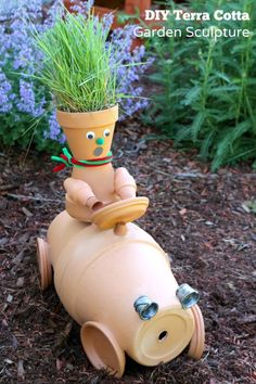 Make this fun and silly race car garden art from terracotta pots! Make this fun and silly race car garden art from terracotta pots! Flower Pot People, Clay Pot People, Clay Pot Projects, Clay Pot Crafts, Diy Clay, Bird Bath Garden, Garden Pots, Garden Ideas, Garden Junk