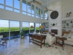 Sunsets in paradise at Ocean Reef in this one-of-a-kind four bedrooms, five baths, plus den canal front home with over 200 ft. of water frontage overlooking wildlife preserve for private waterfront living. Located at the end of a cul-de-sac, this home offers the ultimate privacy and is situated to take advantage of the panoramic sunsets.