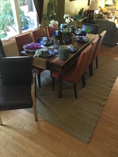 Grass mat under dining table on top of bamboo floors.  New William Sonoma Home metal chairs with Pottery Barn Orange chairs.  Mixing and matching.