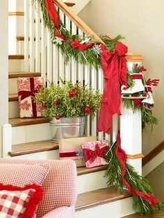 . holiday, stairway, christmas decorations, bucket, christma decor, christmas stairs, stair decor, garland, christmas staircase