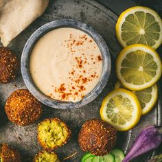 Crispy Falafel with Homemade Pita and Lemon-Garlic Tahini Sauce - Nerds with Knives Garlic Recipes, Vegan Recipes, Fast Recipes, Pesto, Lemon Tahini Sauce, Sauces, Homemade Pita Bread, Garlic Juice, Dips