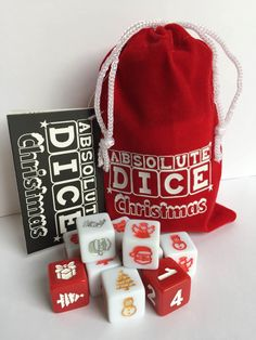 Charming Christmas version of Absolute Dice. Wonderful game in a simple format that everybody can play. No complicated rules or special score sheets. Absolute Dice Christmas comes in a lovely red velvet pouch with snowy motif and drawstring closure, making it the ideal stocking filler for everyone to enjoy during the festive season. It's easy, if you can count, you can play. Have Fun and Merry Christmas.