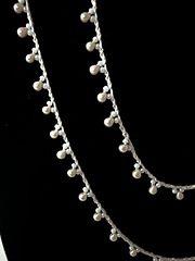 Ravelry: Understatement Necklace pattern by Sharon Hanson